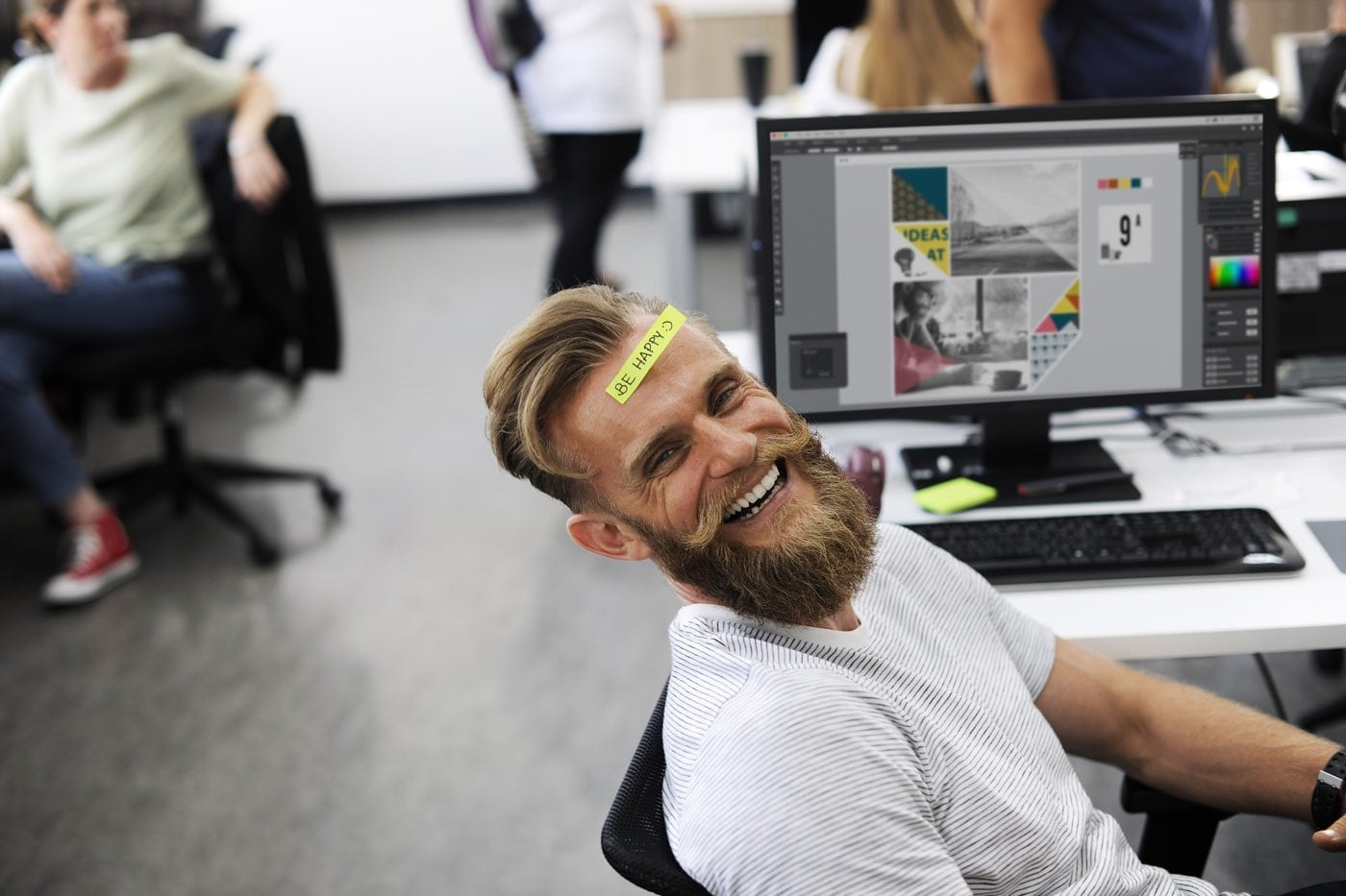 A man laughing whilst working